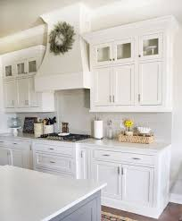 glass cabinets in white kitchen why you should incorporate glass cabinets in your kitchen