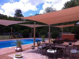 Backyard Shade Sail by Four Outdoor Sun Shade Sails 2012 Design Shading Structures