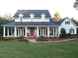 farmhouse with wrap around porch red door wrap around porch all that s missing is a mountain right