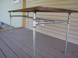 galvanized pipe table legs diy table made from an old door and galvanized pipe