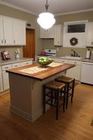 build kitchen island diy kitchen island from stock cabinets diy home