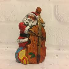 vintage santa claus playing the double bass christmas ornament
