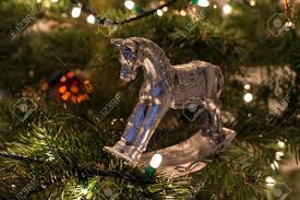 silver rocking ornament on tree stock