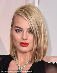 pics of new short bob haircuts on jordan dunn and lilly collins margot robbie works angular new bob hairstyle at the oscars red