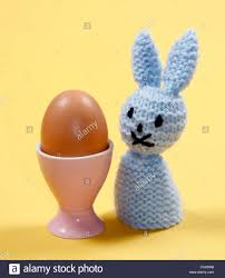 bunny egg cup knitted easter bunny egg warmer with pink egg cup stock photo