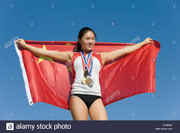 Image Chinese Flag Female Athlete On Winner U0027s Podium Holding Chinese Flag Stock