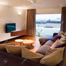 interior design cozy living room with tv set and large window