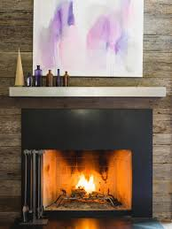 interior simple fireplace mantels with stone wall and black