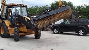 1996 cat 416cit in action w broom attachment tractomax sold