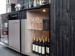 wet bar with glass shelving and undercounter storage for a clean
