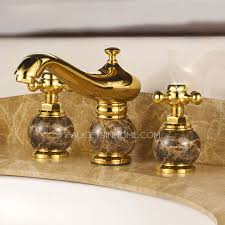 Gold Bathroom Faucet by Antique Gold Marble Handle Three Hole Bathroom Sink Faucet