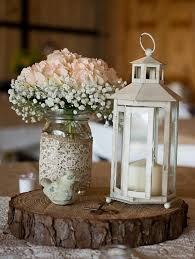 Lanterns With Flowers Centerpieces by Best 25 Mason Jar Centerpieces Ideas On Pinterest Country