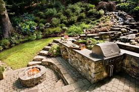 Waterfall In Backyard 13 Fire Pits And Fireplaces In Outdoor Kitchens Hgtv