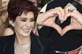 osbourne earrings osbourne wears bling on wedding ring finger as x