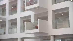 atrium sliding glass doors motion through sliding glass doors in business center stock