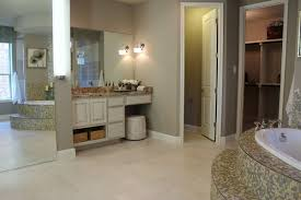 small bathroom design using brown white mosaic tile bathtub