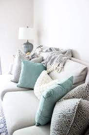 bright white living room printed pillows neutral couch decor