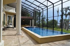 mediterranean swimming pool with exterior stone floors u0026 skylight