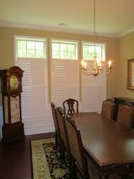 plantation shutters with open transom in a dining room beautiful