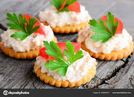 canapé made in canape made from cookies with spicy cheese tomato slice and