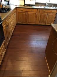 can i put cabinets on vinyl plank flooring lwflooring maple color herringbone wood floor