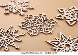laser cut wood snowflakes ornaments wooden stock photo 550555855