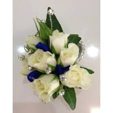 white wrist corsage with blue ribbon u0026amp diamantes