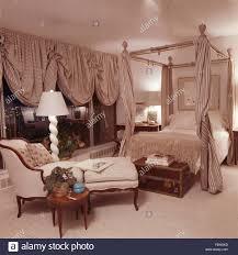 striped festoon blinds on windows in opulent eighties bedroom with