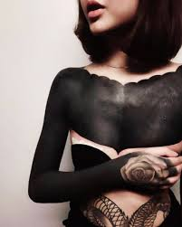 15 striking blackout tattoos that almost look