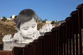 artist creates giant photo of toddler looking over u s mexico
