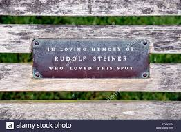 plaque on park bench in memory of rudolf steiner who loved this