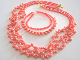complementary of pink 3 strand pink coral necklace and complementary design bracelet