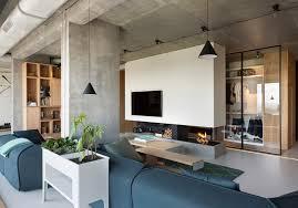 olga akulova installs glass walls and monolithic fireplace within
