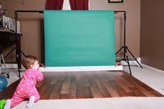 seamless paper backdrop set up with faux flooring and seamless paper photography