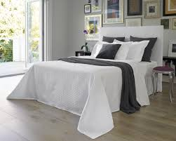 White Bedspread Bedroom Ideas Bedroom White Bedspread Design With Brown Wooden Floor And White