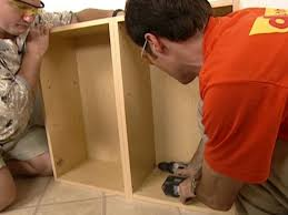 how to fix kitchen base cabinets to wall how to install wall and base kitchen cabinets how tos diy
