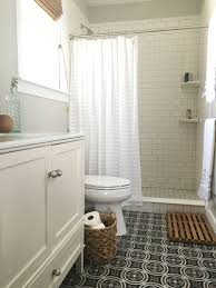 step by step guide to choosing materials for a bathroom renovation bathroom with patterned ceramic floor tile white subway tile and white vanity that homebird