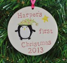 baby s ornament with a penguin personalized