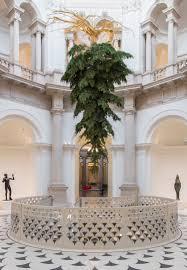 upside down christmas tree hangs in the halls of tate britain