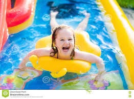 Inflatable Kids Pool Little Playing In Inflatable Garden Swimming Pool Stock Photo