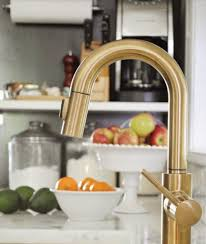 ceramic wall mount brushed brass kitchen faucet two handle pull