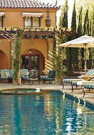 poolside tuscan style love the row of italian cypress on guard