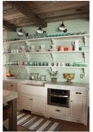 sea glass green subway tile backsplash and open shelves so pretty kitchen shelves