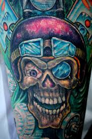 biker cover up skull tattoo with a helmet on rose tattoo bad