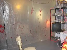halloween house party ideas hanging creepy blood stained plastic sheeting would give the