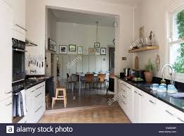 open plan flooring pk chairs around table in open plan kitchen dining area with