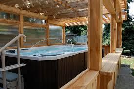 Outdoor Enclosed Rooms - enclosed cedar pergola for outdoor swim spa traditional patio