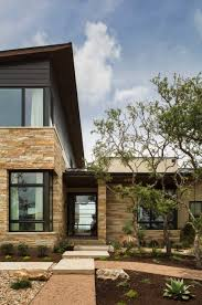 contemporary hilltop home offering serene texas hill country views