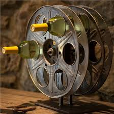 vintage film reel wine rack is perfect for classic hollywood home