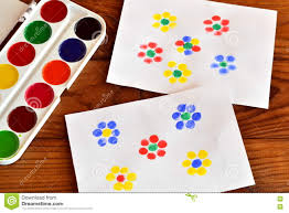 two drawings with flowers finger painting children game